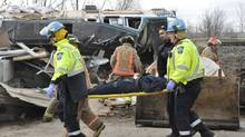Emergency crew help passengers out of a train wreck in Burlington, Ont. (David Ritchie/David Ritchie/CP)