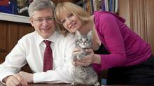 Stephen and Laureen Harper with their cat Stanley, in a photo taken from Stephen Harper's Facebook page