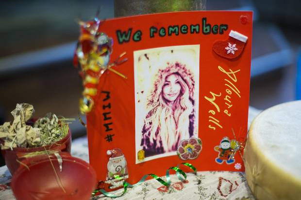Photos of Alloura Wells are displayed at her memorial in Toronto on Dec. 12, 2017. The twenty-seven-year-old trans woman had been missing since July. Her name was finally put to a body discovered in a Rosedale ravine in August.