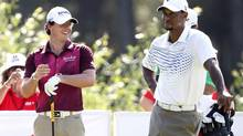 Rory McIlroy and Tiger Woods (UMIT BEKTAS/REUTERS)