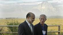 Federal Reserve Chairman Ben Bernanke, left, and Bank of Israel Governor Stanley Fischer walk together outside of the Jackson Hole Economic Symposium, Friday, Aug. 31, 2012. (Ted S. Warren/The Associated Press)