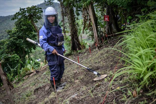 Sok Kanthy, 27, has been working as a deminer with the HALO Trust for two months. She uses an Ebinger GC tool to detect mines hidden in the ground.