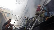 Fire fighters try to extinguish a fire at a multi-storey market complex in Kolkata Feb. 27, 2013. More than 20 fire engines were rushed to the scene of a deadly fire that swept through a six-storey market in India's eastern Kolkata city killing at least 18 people and injuring over a dozen, with the cause of the fire still unknown, local media reported. (Rupak de Chowdhuri/Reuters)