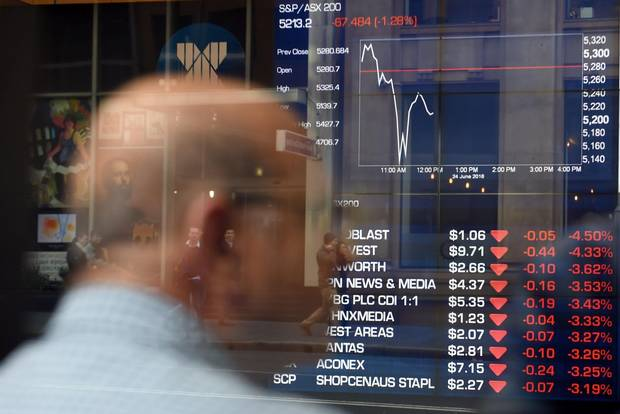 A man monitors trading at a stock exchange in Sydney as results from Britain's European Union referendum favoured a leave vote.