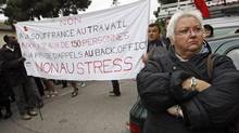 "Employees of France Télécom demonstrate in front of the company's headquarters in Marseille Oct. 20, 2009, to protest against a wave of suicides at the former state monopoly that unions blame on restructuring and work pressure. The banner reads ""No to Torment at Work. No to the Stress. No to 150 Employees in the Same Workplace."" (JEAN-PAUL PELISSIER/REUTERS)"