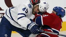 Montreal Canadiens' Brandon Prust (8) grabs Toronto Maple Leafs' Mark Fraser (45) during first period NHL action in Montreal, February 9, 2013. (CHRISTINNE MUSCHI/REUTERS)