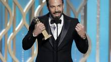"Ben Affleck holds his award for best director for ""Argo"" during the Golden Globe Awards on Jan. 13, 2013, in Beverly Hills, Calif. (Paul Drinkwater/AP)"
