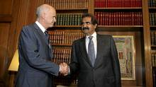 Greece's Prime Minister George Papandreou, left, shakes hands with Qatar's Emir Sheikh Hamad bin Khalifa Al-Thani in Athens Oct. 1, 2011. Qatar Holdings will invest a total of $1-billion in European Goldfields, including $600-million to finance operations in Greece, where the firm has a permit to mine gold, the chief executive of the sovereign wealth fund said on Saturday. (STR/REUTERS)