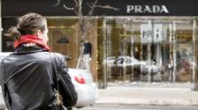 A shopper in Yorkville stops in front of the Prada store on April 1, 2009. (JENNIFER ROBERTS For The Globe and Mail)