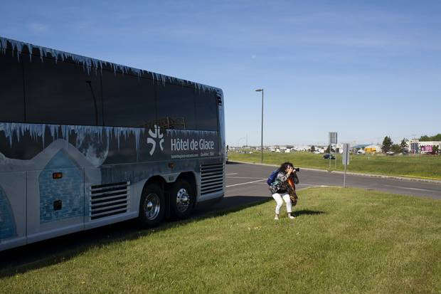 Outside Quebec City: One of the passengers takes a photo at a rest stop.