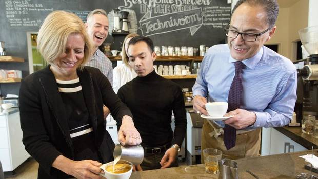 Alberta Premier Rachel Notley and Alberta President of Treasury Board and Minister of Finance Joe Ceci learn to make a latte at a small business in Edmonton on April 15, 2016.