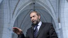 Opposition Leader Tom Mulcair speaks with reporters after an NDP caucus meeting in Ottawa on June 6, 2012. (Adrian Wyld/The Canadian Press)