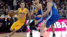 Steve Nash of the LA Lakers, left, drives to the basket in Beijing, Tuesday, Oct. 15, 2013. (Andy Wong/The Associated Press)