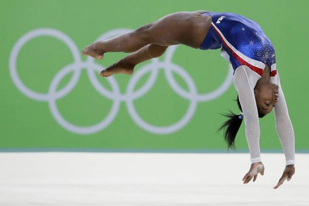 Aug. 11, 2016: Simone Biles performs at the artistic gymnastics women's individual all-around final at the 2016 Summer Olympics in Rio de Janeiro.