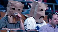 Toronto Maple Leafs fans wear paper bags before the Maple Leafs game against New York Islanders in NHL action in Toronto on Tuesday March 20, 2012. (Chris Young/THE CANADIAN PRESS)