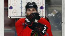 Chicago Blackhawks Patrick Kane watch his teammates skate during practice in Chicago, June 11, 2013. (JEFF HAYNES/REUTERS)