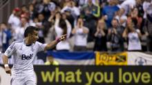 Vancouver Whitecaps FC Camilo Sanvezzo celebrates his goal against the Portland Timbers during second half of MLS action in Vancouver, Sunday, Oct. 6, 2013. (JONATHAN HAYWARD/THE CANADIAN PRESS)