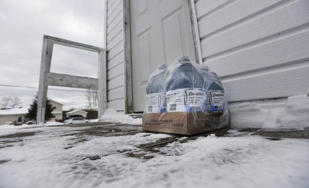 Bottled water is left by the door of a home on the Serpent River First Nation in December, 2016.