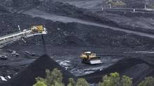 Coal is stockpiled at the Blair Athol mine at the Bowen Basin coal field in Australia. Australia is the world's largest coal exporter. (STAFF/JIM REAGAN/REUTERS)