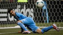 Los Angeles Galaxy goalkeeper Jaime Penedo watches the rebound after making a save during the second half of an MLS soccer game against the Vancouver Whitecaps in Vancouver, B.C., on Saturday August 24, 2013. (DARRYL DYCK/THE CANADIAN PRESS)
