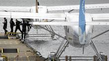 Passengers offload from a Harbour Air seaplane in Vancouver, March 13, 2012. (John Lehmann/The Globe and Mail/John Lehmann/The Globe and Mail)