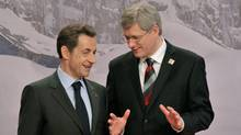 Nicolas Sarkozy, left, French President, speaks with Canadian Prime Minister Stephen Harper prior to the group photo at the Francophonie Summit in Montreux, Switzerland, Saturday, Oct. 23, 2010. (Dominic Favre/Dominic Favre/The Associated Press)
