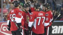 Ottawa Senators, from left, Michael Sdao, Clarke MacArthur, Kyle Turris, Joe Corvo and Mike Hoffman celebrate MacArthur's goal against the Calgary Flames during third period NHL preseason action on Monday, Sept. 16, 2013 in Saskatoon, Sask. (Liam Richards/THE CANADIAN PRESS)