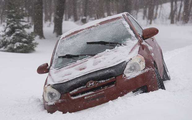 A car is shown in a ditch in Saint Lazare, west of Montreal, on Dec. 29, 2015.