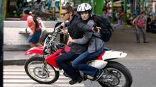 """This film image released by Universal Pictures shows Rachel Weisz as Dr. Marta Shearing, right, and Jeremy Renner as Aaron Cross in a scene from """"The Bourne Legacy."""" (Mary Cybulski/AP)"""