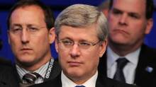 Prime Minister Stephen Harper, middle, sits in front of Minister of Defence Peter MacKay, left, and Minster of Foreign Affairs John Baird as they take part in a meeting on Afghanistan during the NATO Summit in Chicago, Ill., on Monday, May 21, 2012. (Sean Kilpatrick/The Canadian Press)