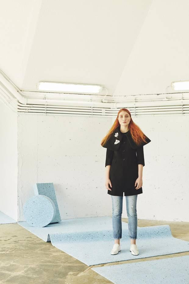 Comme Des Garçons coat, $1,630 through www.ssense.com. Levi's jeans, $108 through www.levi.ca. Studio Method(e) brooches, $100 each through www.studiomethode.com. Céline shoes, $1,200 at Nordstrom.