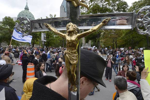 Sept. 14, 2013: Demonstrators take part in a protest against the proposed Charter of Values of the Parti Québécois government of the day. The PQ lost to the Liberals in a 2014 election, where soon-to-be-premier Philippe Couillard campaigned promising secularism legislation similar to Bill 62.