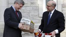 Prime Minister Stephen harper receives two cases of beer from U.S. Ambassador David Jacobson in mid-March, 2010, after winning a bet with President Barack Obama when Canada's men's hockey team won the Olympic gold medal (Chris Wattie/Reuters)