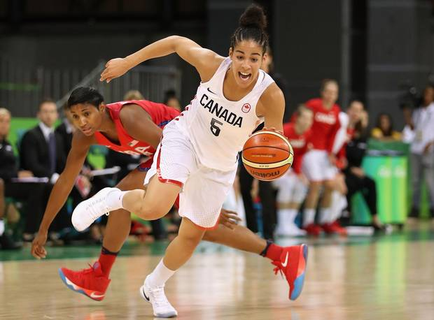 Kia Nurse of Canada controls the ball past Angel Mccoughtry of United States during the women's basketball game on Day 7 of the Rio 2016 Olympic Games on August 12, 2016 in Rio de Janeiro, Brazil.