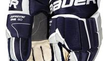 Bauer hockey gloves are seen in this file photo. Canadian companies say they'll benefit from an cut to import tariffs on hockey equipment. (Handout)