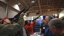Gun enthusiasts at the Toronto Sportsmen's Show at Exhibition Place in 2009. (Kevin Van Paassen/The Globe and Mail/Kevin Van Paassen/The Globe and Mail)
