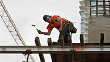 Workers construct another condo development in downtown Vancouver on March 26th, 2010. (Simon Hayter/SIMON HAYTER)