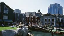 People on the waterfront in Historic Properties of Halifax. (Getty Images)
