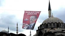 """A poster of Prime Minister and presidential candidate in Turkeys Aug. 10 presidential election, Recep Tayyip Erdogan that reads """" Man of the Nation"""" in Istanbul, Turkey, Thursday, Aug. 7, 2014. (Emrah Gurel/AP)"""