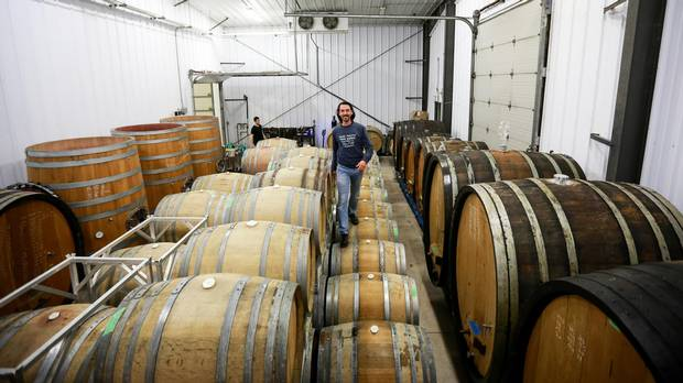Vigneron François Morissette of the Pearl Morissette winery walks atop his French oak barrels while his wine slowly ages in October.