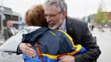 Gerry Adams gets a warm welcome after his release from five days of police interrogation. (Peter Morrison/AP)