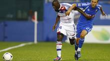 Olympique Lyonnais Mouhamadou Dabo (14) fights for the ball against Montreal Impact's Justin Mapp during their friendly soccer match in Montreal, July 24, 2012. (OLIVIER JEAN/REUTERS)
