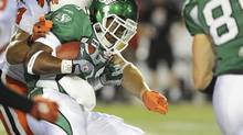 Saskatchewan Roughriders running back Kory Sheets is brought down during the first half CFL football game in Regina, Saskatchewan September 29, 2012. (STRINGER/REUTERS)