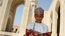 An Omani boy reads the Koran in the courtyard of Muscat's Grand Mosque before the noon prayer on the first Friday of the holy month of Ramadan in the Gulf sultanate of Oman on September 5, 2008. (MOHAMMED MAHJOUB/MOHAMMED MAHJOUB/AFP/Getty Images)