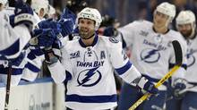 Tampa Bay Lightning's Martin St. Louis celebrates his goal during the third period of an NHL hockey game against the Carolina Hurricanes, Sunday, April 21, 2013, in Tampa, Fla. (MIKE CARLSON/THE CANADIAN PRESS)