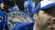 Craig Grignon of Barrie, Ont, right, and Warren Baxter of Oakville, who calls himself a 'super fan,' were among the 48,857 at Rogers Centre in Toronto for the first game of the Blue Jays' 2013 season. (Peter Power/The Globe and Mail)