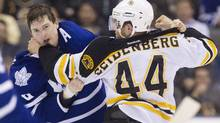 Toronto Maple Leafs' Colby Armstrong takes a punch from Boston Bruins' Dennis Seidenberg in the second period. (FRED THORNHILL/Fred Thornhill/Reuters)