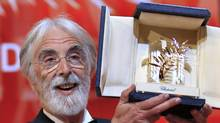 "Director Michael Haneke reacts after receiving the Palme d'Or award for the film ""Amour"" during the awards ceremony of the 65th Cannes Film Festival, May 27, 2012. (YVES HERMAN/Reuters/YVES HERMAN/Reuters)"