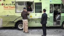 Tamara Chaikin serves up local food at Localista food truck in downtown Toronto, May 16, 2014. (Deena Douara/The Globe and Mail)