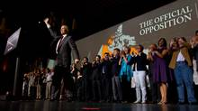 NDP leader Jack Layton is flanked by his fellow MP's as he waves after delivering a speech to open the party's 50th anniversary convention in Vancouver, B.C., on Friday June 17, 2011. (DARRYL DYCK/THE CANADIAN PRESS)